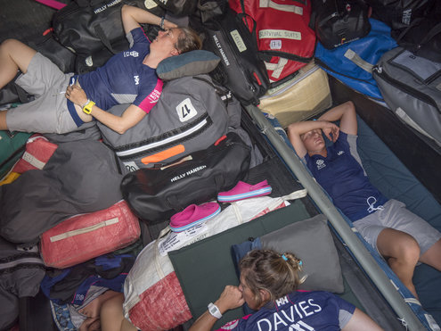 AT SEA - JANUARY 04: In this handout image provided by the Volvo Ocean Race, onboard Team SCA. Libby Greenhalgh,Sam Davies,and Abby Ehler sleep in the bow in light winds during Leg 3 on January 4, 2015 between Abu Dhabi, UAE and Sanya, China. The Volvo Ocean Race 2014-15 is the 12th running of this ocean marathon. Starting from Alicante in Spain on October 11, 2014, the route, spanning some 39,379 nautical miles, visits 11 ports in 11 countries (Spain, South Africa, United Arab Emirates, China, New Zealand, Brazil, United States, Portugal, France, the Netherlands and Sweden) over nine months. The Volvo Ocean Race is the world's premier ocean race for professional racing crews. (Photo by Corinna Halloran/Team SCA/Volvo Ocean Race via Getty Images)